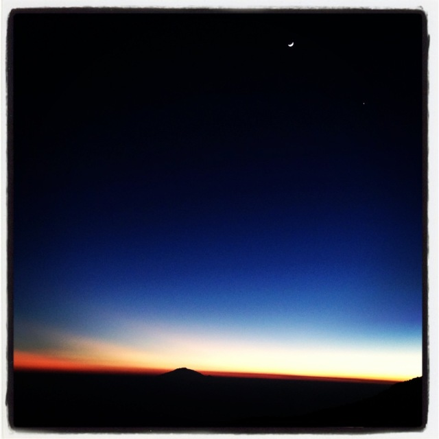 The sun sets at the end of the fifth day on the #Climb4Cord as the moon rises over Mt. Meru in the background.